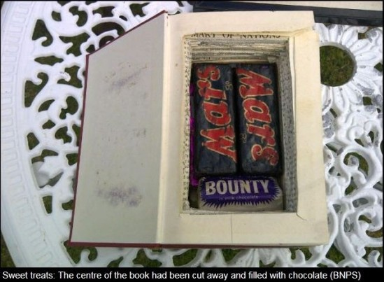 Hollowed out book with sweets inside